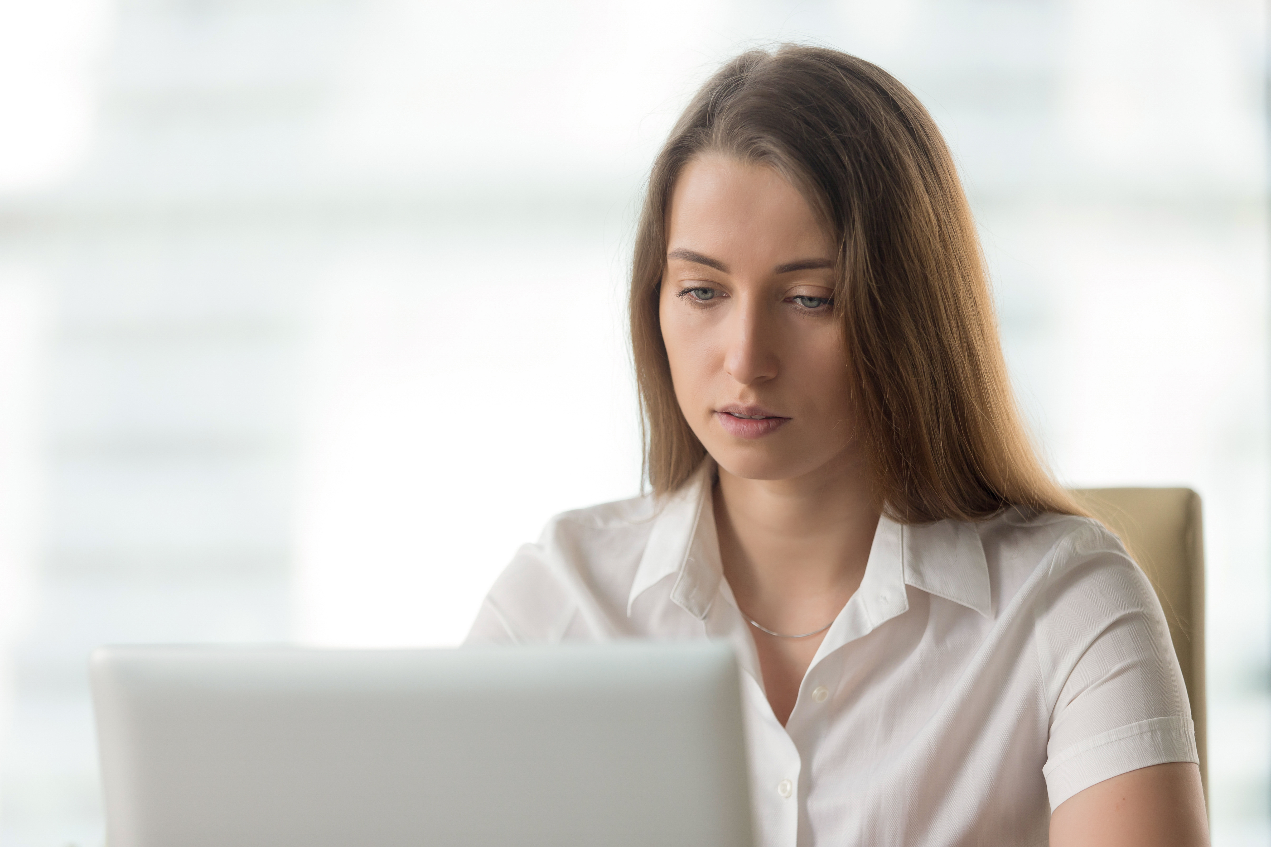 Resources to Help You Find the Right Attorney in the Port Huron area. A woman is intently searching on her computer.
